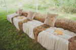 Ceremony Seating in an Amphitheatre Setting Using Hay and Some Brown Folding Chairs